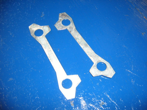 Brake caliper locking tabs